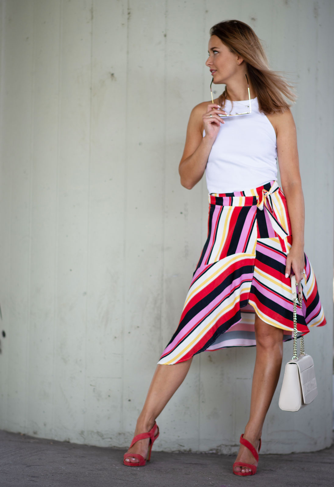 confident woman wearing statement skirt